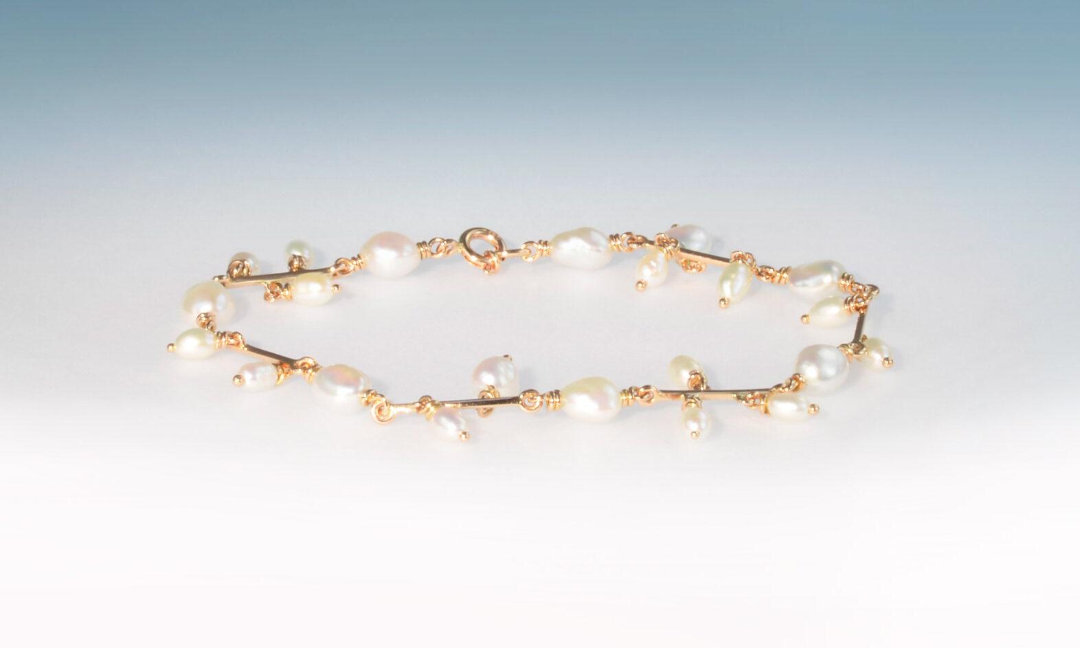 Bracelet rg perlen. Bracelet Süsswasserperlen und Rotgold 750, CHF 2200.-