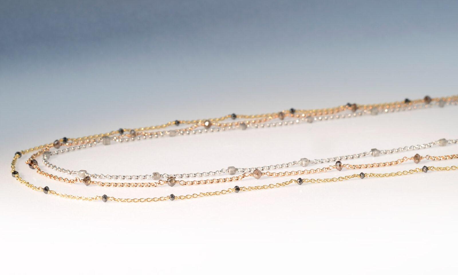 Diamkette weiss rot gelb. Kette Gelbgold 750 mit schwarzen Diamanten, CHF 1500.- / Rotgold 750 mit braunen Diamanten, CHF 1800.- / Weissgold 750 mit grauen Diamanten, CHF 1850.-