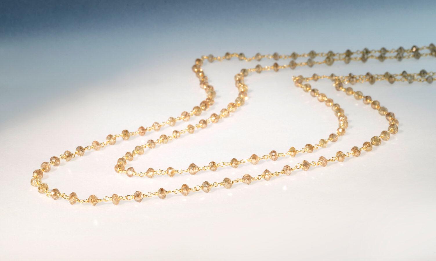Kette diam gelb. Kette Diamant gelb-braun naturfarben, d 3 mm, 26.88 ct., von Hand montiert auf Draht aus Gelbgold 750, Länge 121 cm, CHF 7100.-