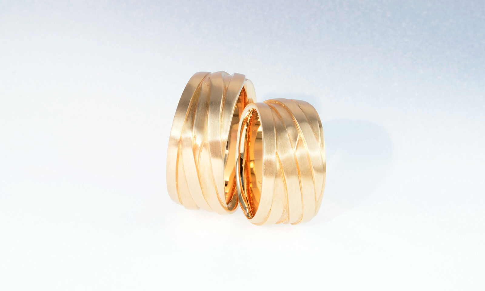 Partnerringe Rotgold. Trauringe Rotgold 750, Breite 10 - 11 mm, CHF 3600.- / 3450.-