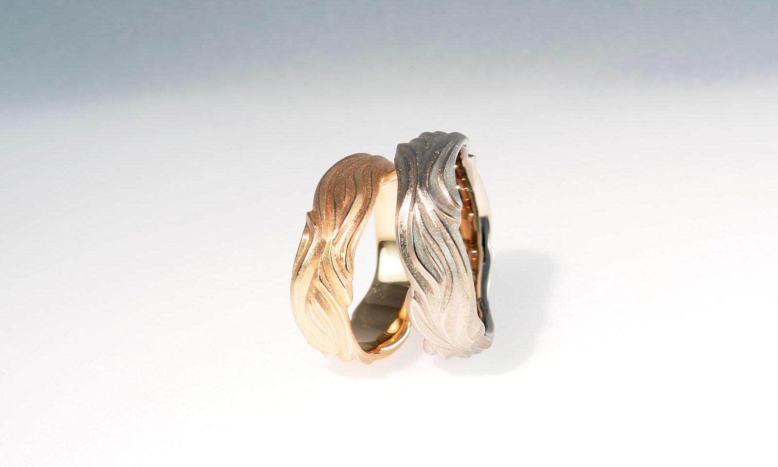 Ringe wellen. Trauringe Rotgold 750 und Weissgold 750, Breite 6-7 mm, CHF 2350.- / CHF 2590.-